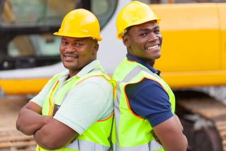ppe: cheerful afro american mine workers at mining site