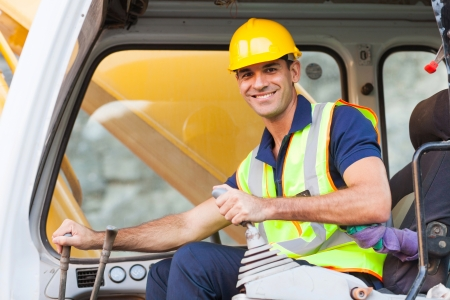 road worker: cheerful excavator operator on construction site Stock Photo