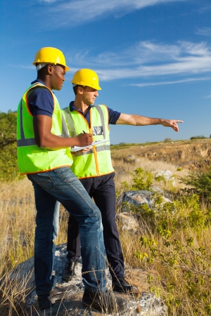 surveyors: two male surveyors at work