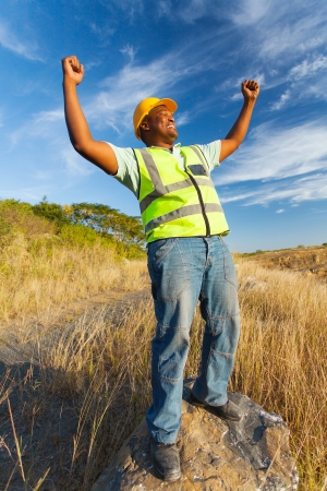 blue collar: successful afro american construction worker outdoors