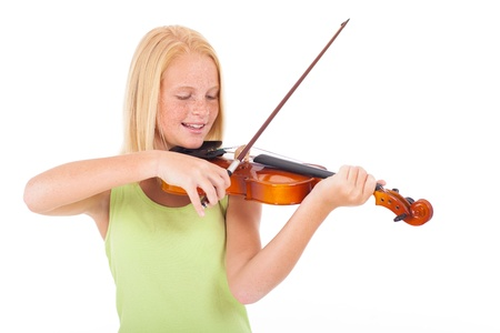 pre teen girl: happy preteen girl playing violin against white background Stock Photo