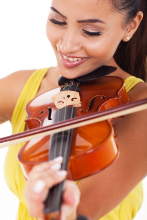 beautiful young woman playing violin on white background photo