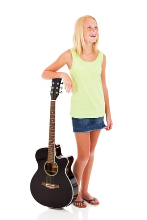 pre teen girls: beautiful young pre teen girl posing with a guitar on white background