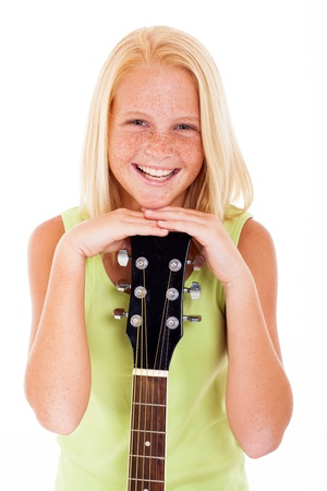 girl playing guitar: portrait of young preteen guitarist laughing on white background Stock Photo