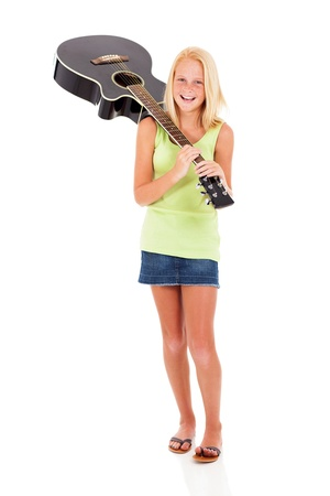 pre teen girl: smiling preteen girl carrying a guitar isolated on white