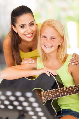 pre adult: portrait of friendly teacher with her music learner Stock Photo