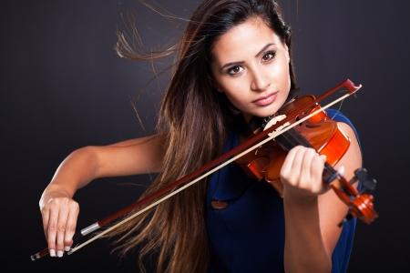 professional practice: professional violinist on black background