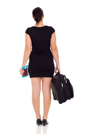 rear view of young female business traveler isolated on white photo