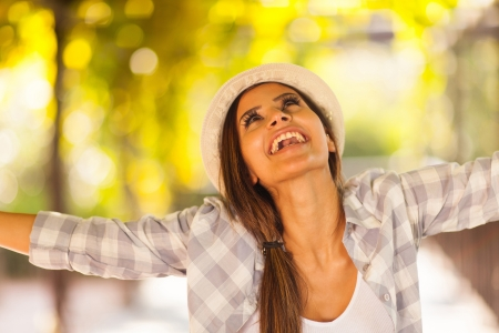 outstretched arms: cheerful woman outdoors with her arms outstretched