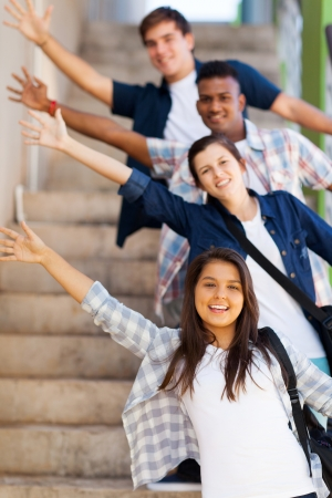 student: playful group of high school students waving hands Stock Photo