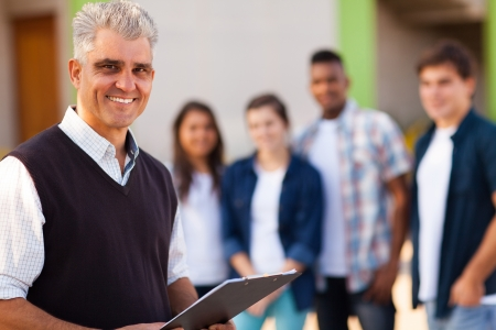 learners: happy middle aged male high school teacher Stock Photo