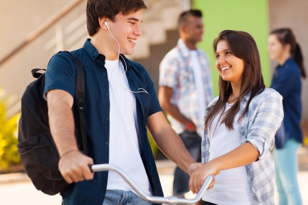 cute teen high school friends talking on campus photo