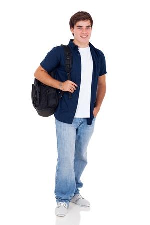 ni�o parado: sonriendo escolar adolescente de pie alto en el fondo blanco