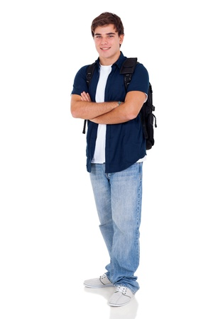 good looking teenage guy: portrait of young high school student with arms folded over white background