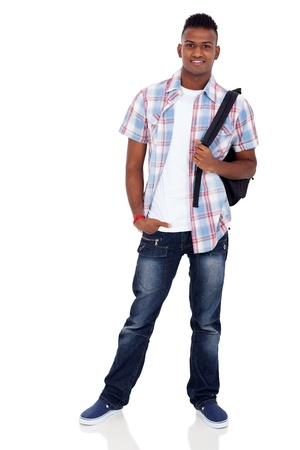 smiling indian teenager boy with schoolbag standing on white background Stock Photo