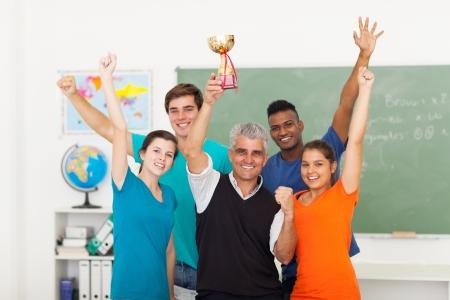 high class: happy high school class wining a trophy Stock Photo