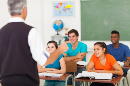 learners: rear view of high school teacher teaching students in classroom Stock Photo