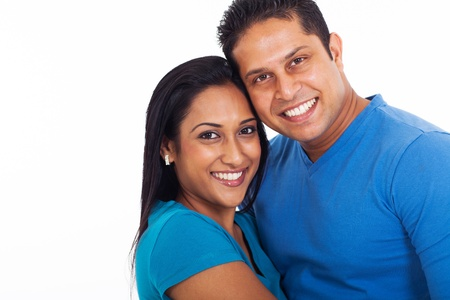 married couples: portrait of young indian couple over white background