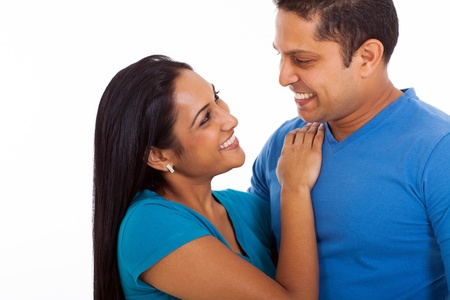 cute loving indian couple looking each other on white background photo