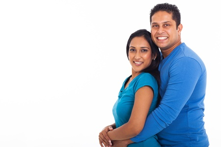 cheerful young indian couple on white background photo