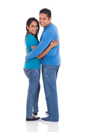 beautiful indian couple looking back isolated on white photo