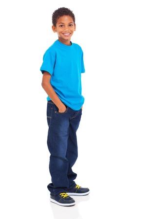 分離上の白い背景に立っているかわいいインドの少年 写真素材