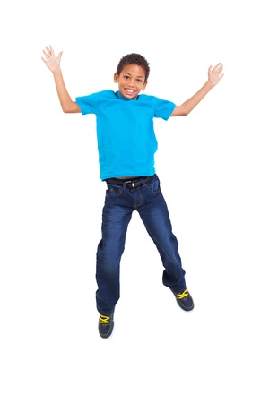 lovely young african american boy jumping on white background photo