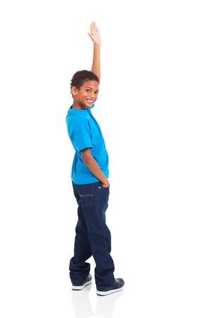 happy little indian boy waving goodbye on white background Stock Photo - 20357916