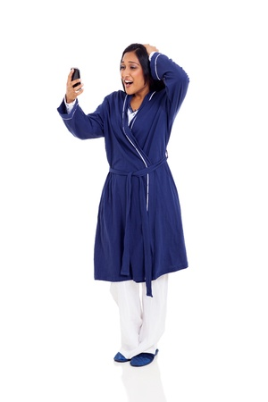 sleepwear: young indian woman over slept and late for work