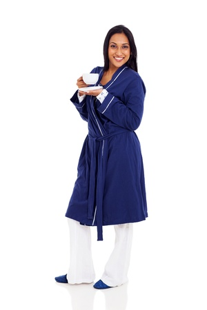 full length portrait of indian woman in pajamas drinking coffee photo