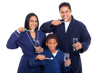 healthy young indian family brushing teeth together in pajamas photo