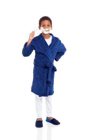 playful little boy shaving face isolated on white Stock Photo - 20356543