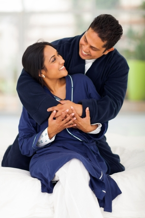 lovely young indian couple embracing on bed at home Stock Photo - 20378964