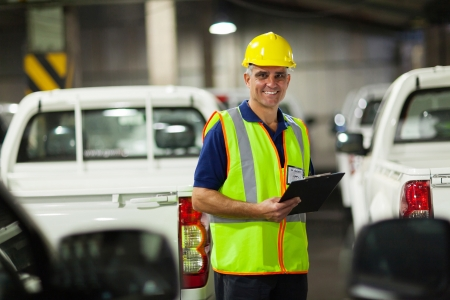 middle aged vehicle shipping company worker inside warehouse Stock Photo - 20665381