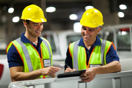two shipping company workers recording vehicles before exporting Stock Photo - 20665383