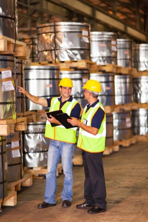 shipping company workers counting roll steel pallets in warehouse Stock Photo - 20659357