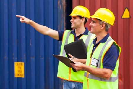 cheerful shipping company workers working at the harbor Stock Photo - 20669065