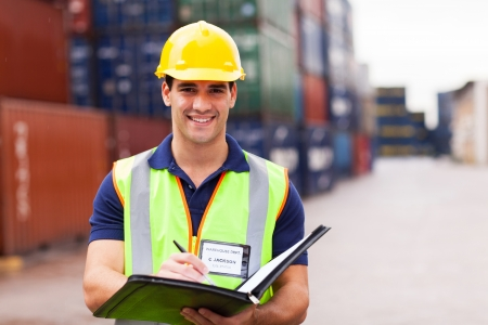 SHIPPING CONTAINERS: young harbor container depot worker