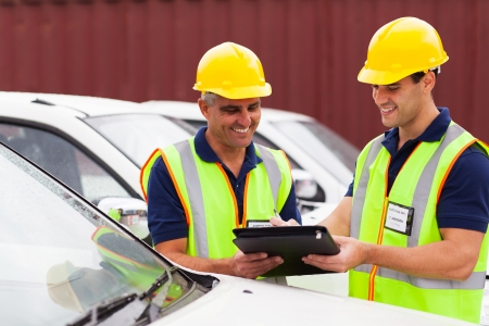 cheerful shipping company workers checking vehicles report before loading Stock Photo - 20667549