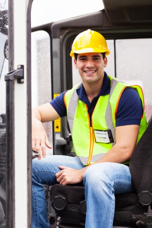skilled operator: portrait of smiling young forklift driver Stock Photo
