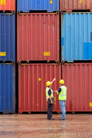 depot: shipping company workers counting containers at depot