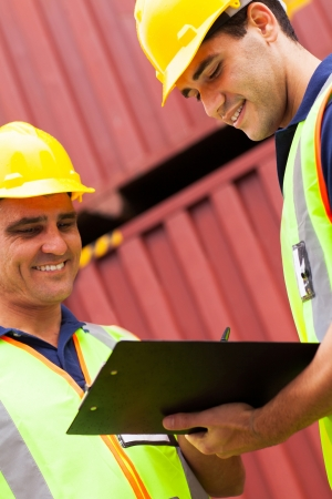 smiling harbor workers recording containers before exporting Stock Photo - 20660013