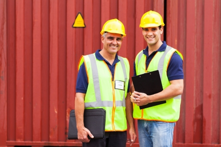 two shipping company workers standing in front of containers Stock Photo - 20660196