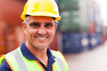 depot: happy senior harbor worker at container depot Stock Photo
