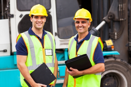 harbor warehouse worker standing in front of container forklift Stock Photo - 20659982