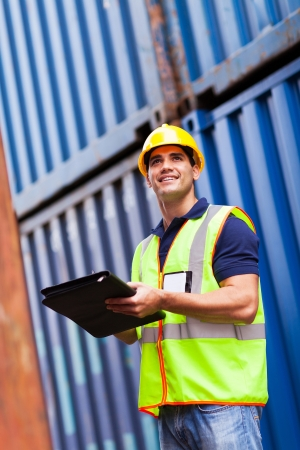 depot: handsome young harbor container depot worker Stock Photo