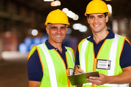 two warehouse workers working inside storage area photo
