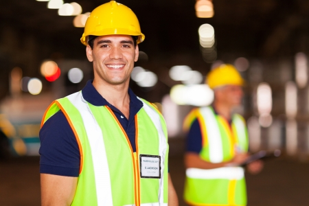 portrait of smiling young warehouse worker indoors photo
