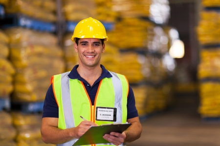 work safety: portrait of young warehouse worker indoors