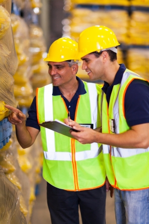 two warehouse workers doing stock take photo